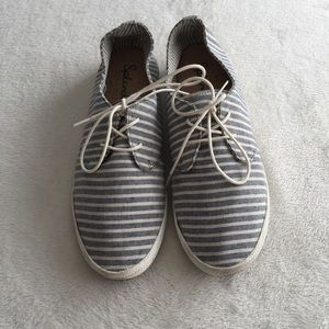 Striped canvass shoes.